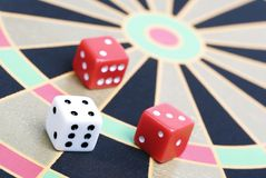 Dice on game board Royalty Free Stock Images