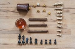 Dice game, chess piece, cigars and alcoholic beverages. Dice game, chess piece with cigars and alcoholic photographed in directly above royalty free stock photo
