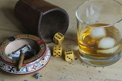 Dice game. With cigar and alcoholic beverage Royalty Free Stock Image