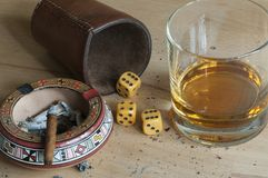 Dice game. With cigar and alcoholic beverage Stock Image