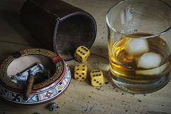 Dice game. With cigar and alcoholic beverage Royalty Free Stock Photography