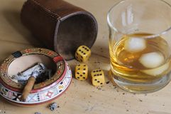 Dice game. With cigar and alcoholic beverage Stock Photography