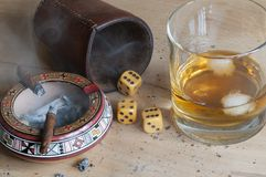 Dice game. With cigar and alcoholic beverage Royalty Free Stock Photos
