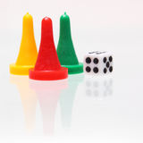 Dice and game pieces Royalty Free Stock Photo
