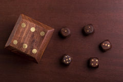 Dice game. The wooden dices on a table Stock Images