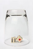 Dice in Glass upside down Royalty Free Stock Photography