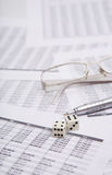Dice, glasses  and pen Royalty Free Stock Image