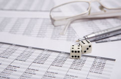 Dice, glasses  and pen Stock Image