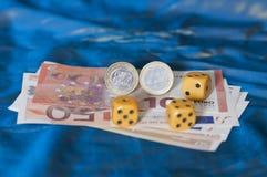 Dice on Greek euro Royalty Free Stock Image
