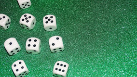 Dice with a green background. Gambling concept. royalty free stock photos