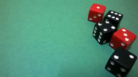 Dice on a green background. Royalty Free Stock Images