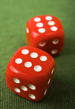 Dice on Green Felt Stock Photos