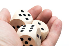 Dice, hand, dice game. Three game cubes in a hand with white background Stock Photos