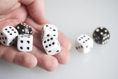 Dice in the hand of man. Royalty Free Stock Images