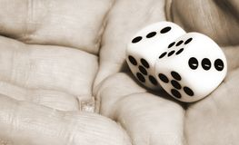 Dice In Hand Sepia. Dice in womans hands. sipia toned Royalty Free Stock Photos
