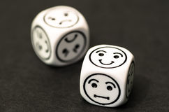 Dice with happy emoticon side. Stock photo Royalty Free Stock Photography