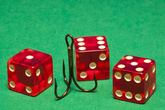 Dice and Hook Royalty Free Stock Photography