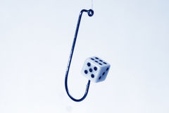Dice on hook Stock Images