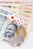 Dice and Indian currency Royalty Free Stock Image