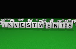 Dice investments. Dice on a green carpet making the word investments Royalty Free Stock Image