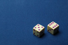 Dice from an ivory on cloth Stock Photo