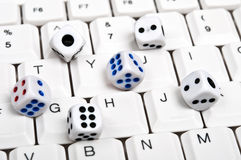 Dice on keyboard Stock Image