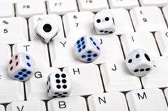Dice on keyboard Stock Image