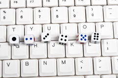 Dice on keyboard Royalty Free Stock Image