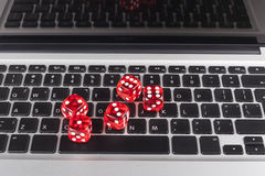 Dice on Keyboard Royalty Free Stock Photography