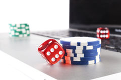 Dice on Laptop Royalty Free Stock Photography