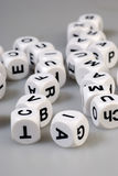 Dice letters Stock Photos