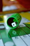 Dice on ludo board. A dice on a ludo board with a reflection in the glass of the board Royalty Free Stock Photography