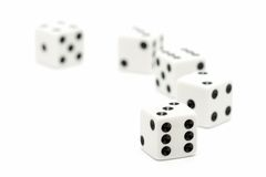 Dice macro highkey over white. Dice macro, highkey over white with focus on front dice. shallow depth of field stock image