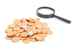 Dice,magnifier and coins Royalty Free Stock Photography