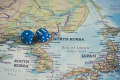 North Korea challenge of international war concept. Dice on map with North Korea country, concept of risk of war and risky challenge between nations royalty free stock photo