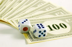 Dice and money. On a gamble table stock images