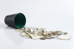 Dice and money Stock Photo