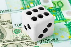Dice on money background Royalty Free Stock Photography