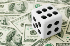 Dice on money background Stock Photography