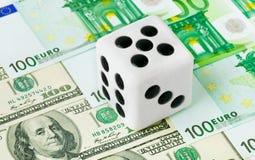 Dice on money background Royalty Free Stock Image