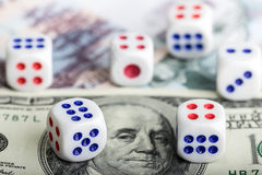 Dice on money background Stock Image
