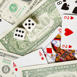 Dice are on money and cards. The dice are on the money and playing cards Royalty Free Stock Photos