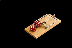 Dice on mouse trap Royalty Free Stock Image