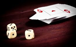 Dice near playing card, poker game texas Royalty Free Stock Image