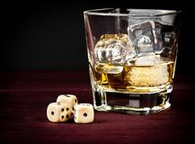 Dice near whiskey glass, concept of game Royalty Free Stock Photography