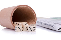 Dice and newpaper still life Royalty Free Stock Image