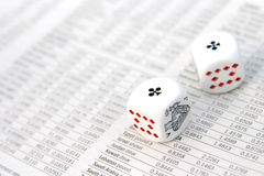 Dice on a newspaper. Stock Images