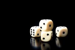 Dice on old wood black table Stock Photo
