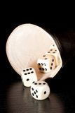 Dice on old wood black table near a container Royalty Free Stock Photography
