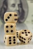 Dice On Big Dollar Background Royalty Free Stock Photos